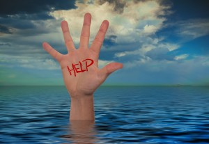 A hand sticking out of water with the word help on it.